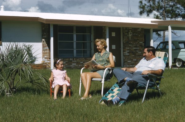 Family_in_front_of_their_home-_Venice_East,_Florida_(8865570965)